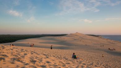 Photo of Des massages à prix libres sur la Dune du Pilat face au coucher de soleil